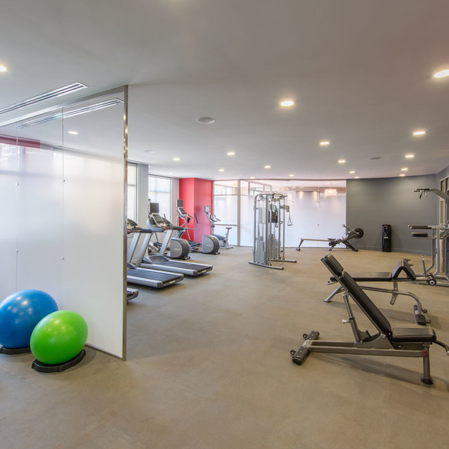 Fitness center at The Bradley Braddock Road Station Apartments