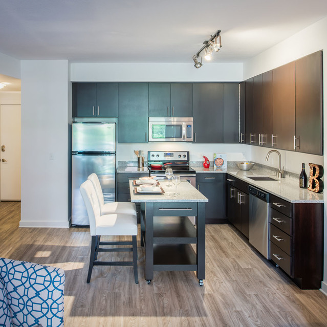 Kitchen and living room at The Bradley Braddock Road Station Apartments