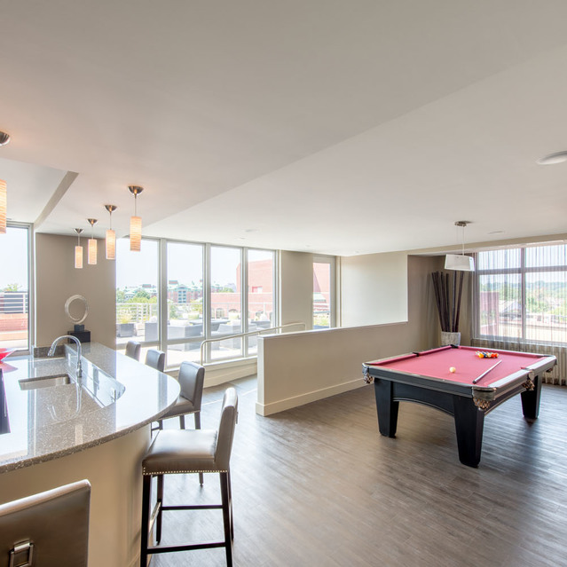 Billiards table in resident lounge at The Bradley Braddock Road Station Apartments
